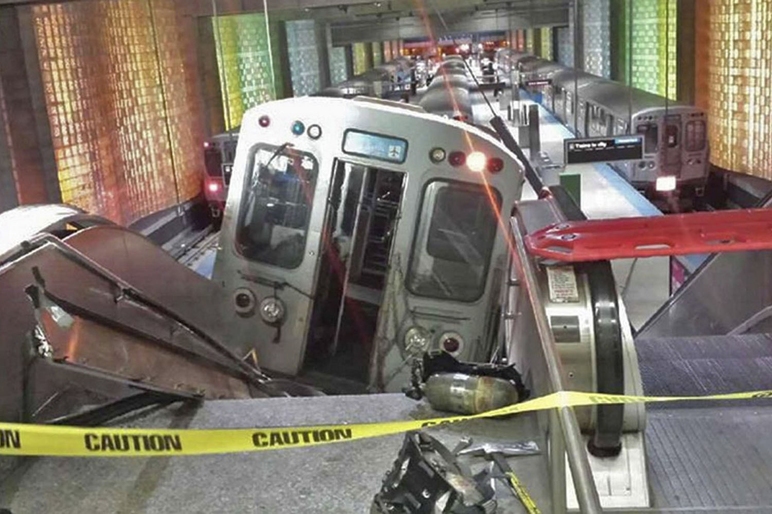 Mar. 24, 2014.                                A handout photo shows a derailed commuter train resting on an escalator at O'Hare international airport in Chicago Thirty-two people were injured after the train derailed and hit a platform early on Monday.