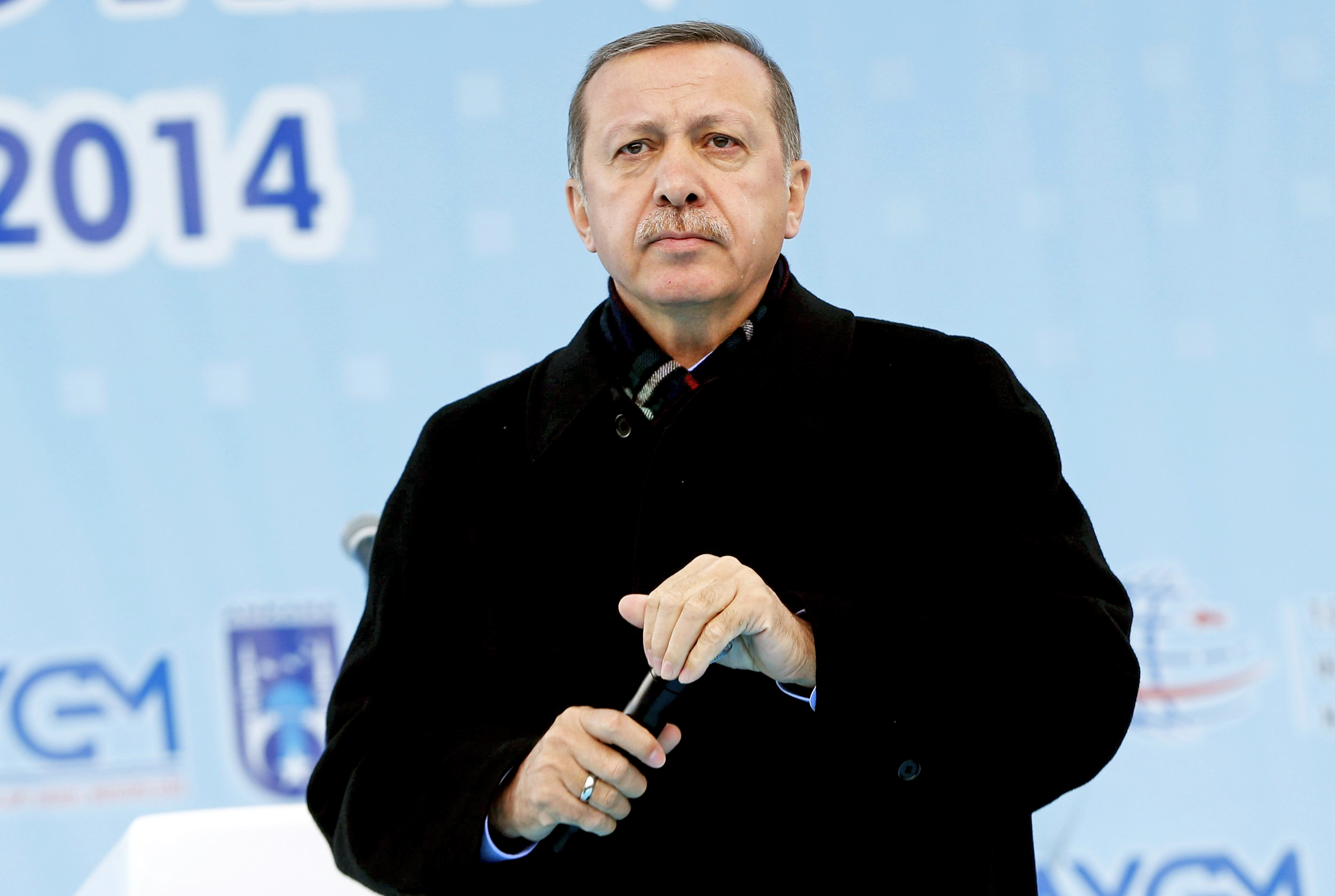 Turkey's Prime Minister Tayyip Erdogan addresses the crowd during an opening ceremony of a new metro line in Ankara on March 13, 2014.