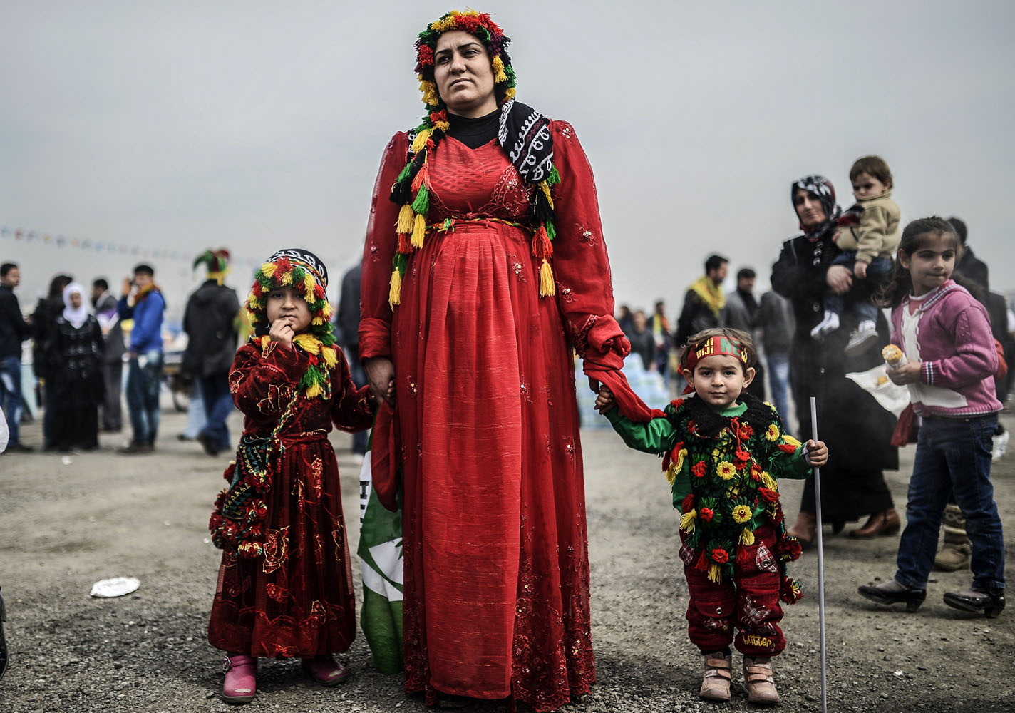 Mar. 23, 2014. A woman stands with her daughters during Newroz celebrations at Kazlicesme district in Istanbul. Newroz, which means  new day  in Kurdish, marks the first day of Spring.