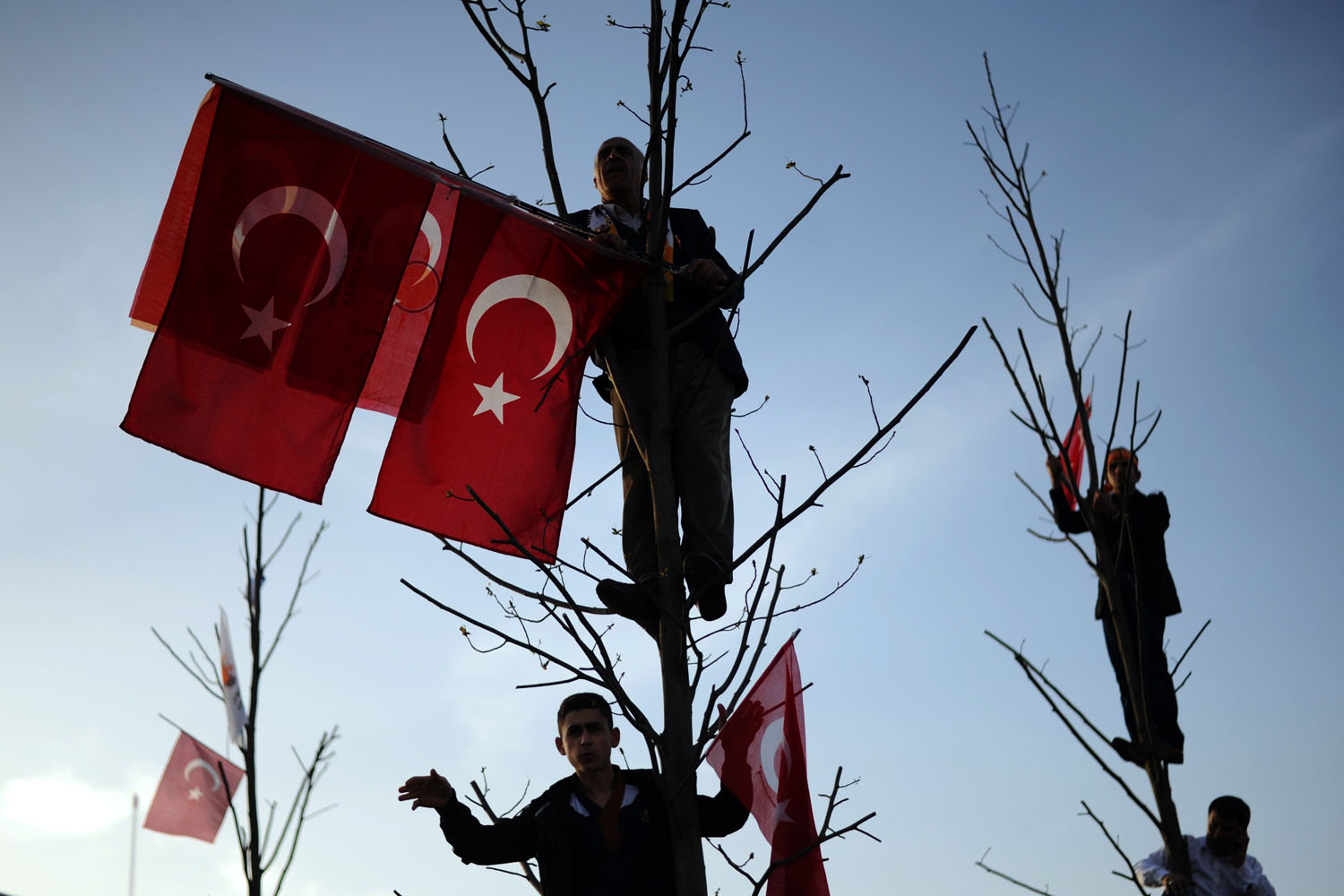 Mar. 23, 2014. Justice and Development Party (AKP) supporters wait on a tree during a rally in Istanbul. Prime Minister Recep Tayyip Erdogan rallied hundreds of thousands of supporters on Sunday, dismissing accusations of intolerance by Western and domestic critics.