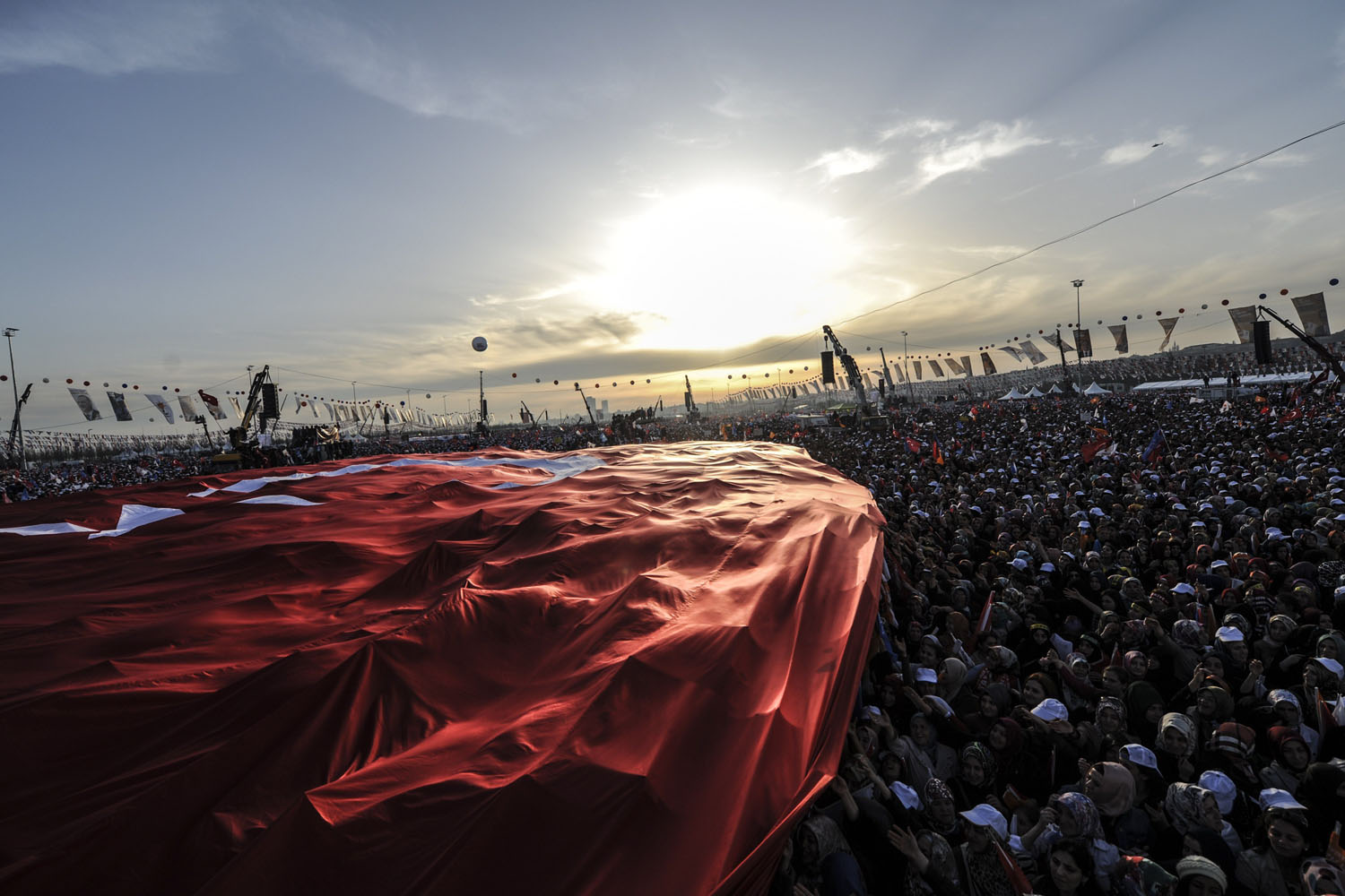 Mar. 23, 2014. Supporters of Turkey's Prime Minister Tayyip Erdogan hold a giant Turkish flag during an election rally in Istanbul.  Erdogan rallied hundreds of thousands of supporters on Sunday, dismissing accusations of intolerance by Western and domestic critics.