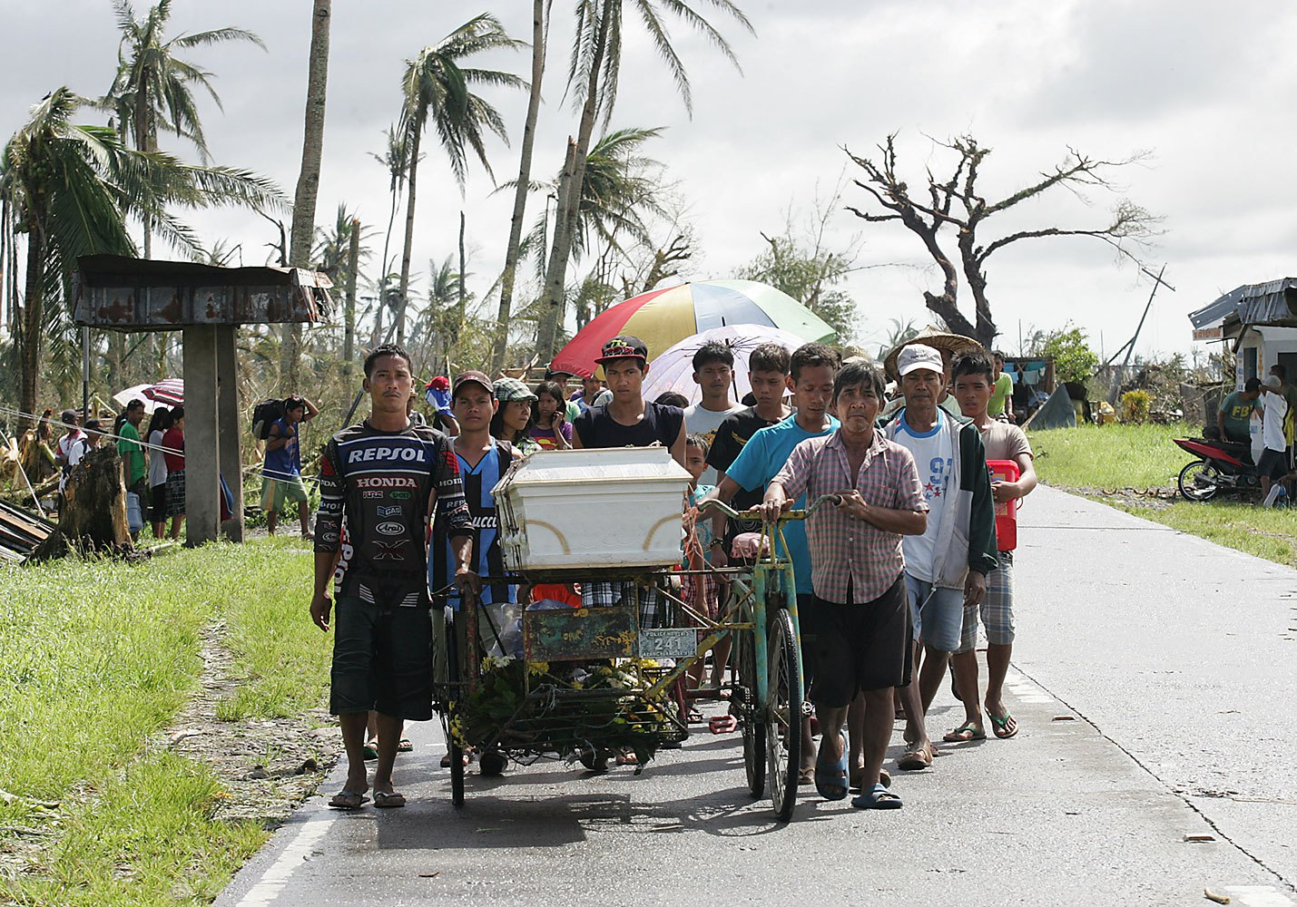 Residents wheel a family member to the cemetery on Nov. 10, 2013, in Santa Fe, in the Philippines' Leyte province