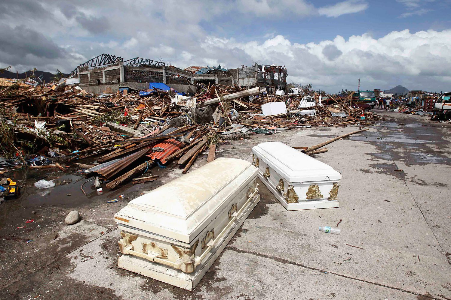 Empty coffins lie on a street near ruined houses on Nov. 10, 2013, after Supertyphoon Haiyan battered the city of Tacloban, in central Philippines