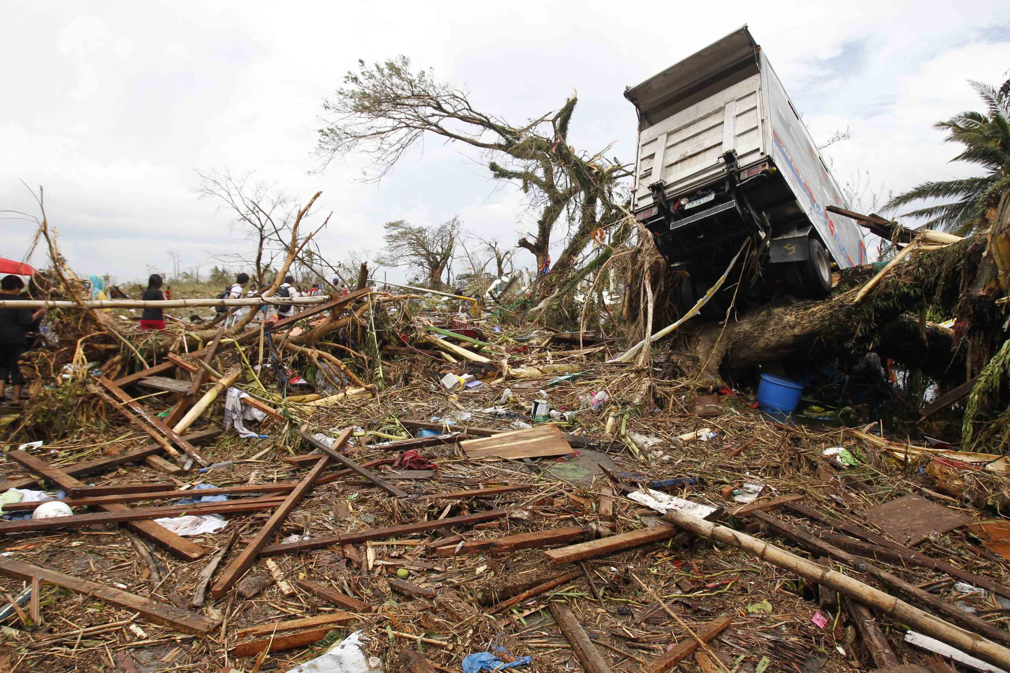 A truck is seen on a tree in the aftermath of Supertyphoon Haiyan in Tacloban, the Philippines, on Nov. 9, 2013