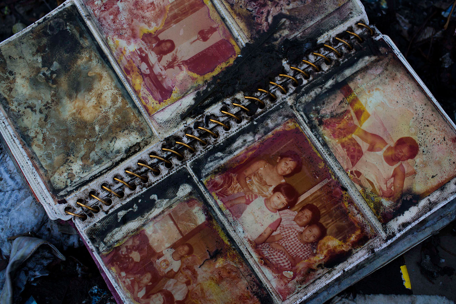 A photo album lies in the rubble in a neighborhood destroyed by Typhoon Haiyan in Tacloban, Philippines on November 22, 2013.