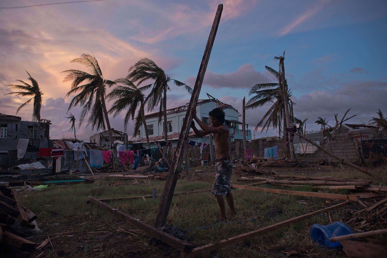 A typhoon victim constructs his new home in Tanauan on November 20, 2013.