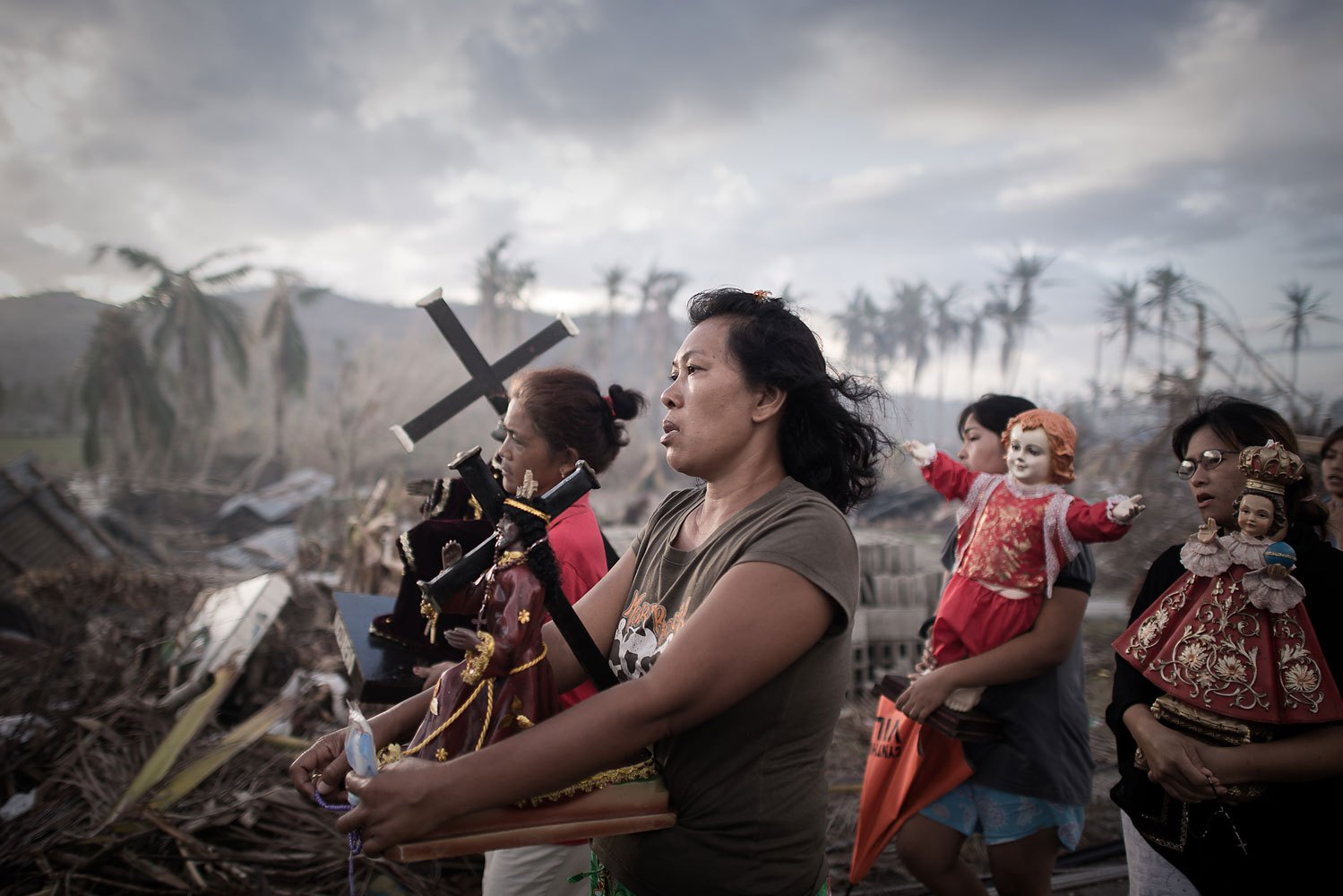 Survivors of Typhoon Haiyan march during a religious procession in Tolosa on the eastern Philippine island of Leyte on November 18, 2013.