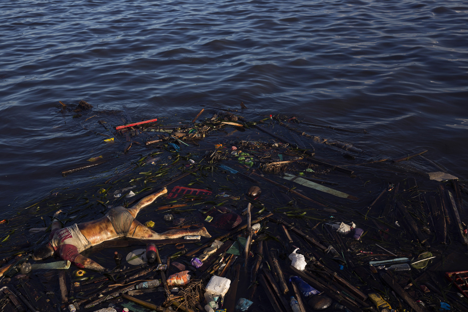 The body of a man killed by Typhoon Haiyan is washed up along the shore in Tacloban, Philippines on November 16, 2013.