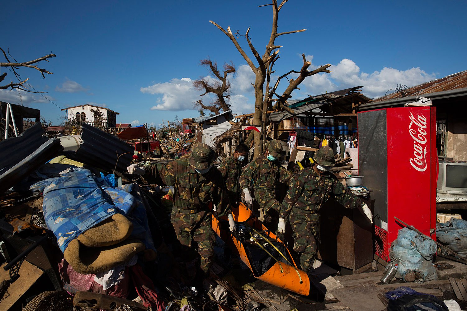 Soldiers and search and rescue teams collect bodies of people killed by Typhoon Haiyan in Tanuan, Philippines on November 15, 2013.
