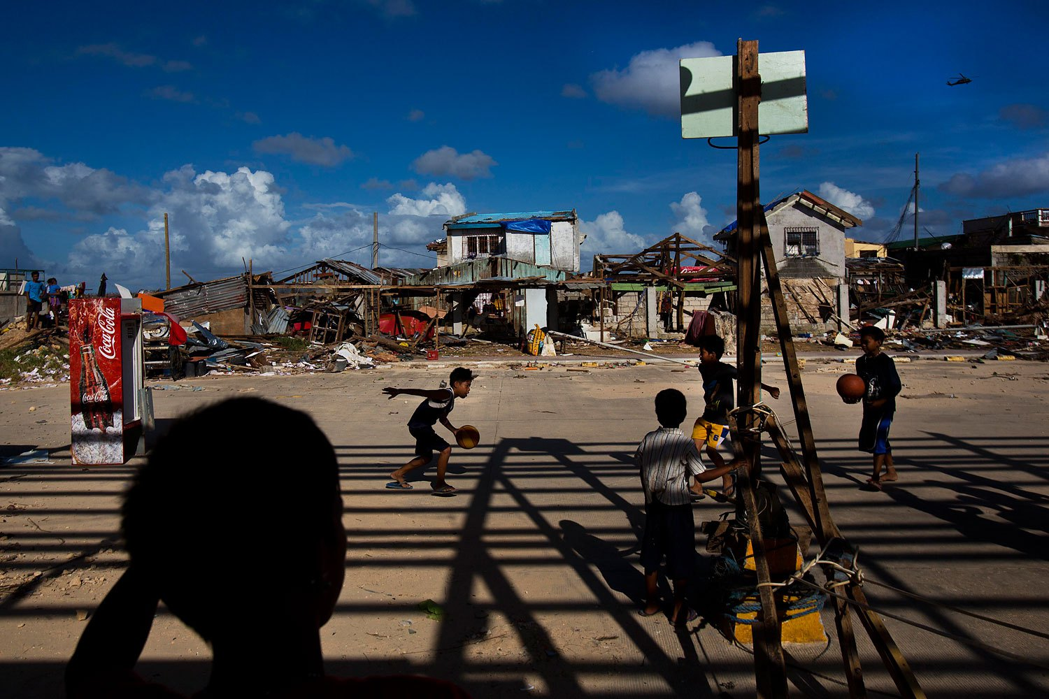 Typhoon Haiyan survivors play basketball at the destroyed port in the town of Guiuan, Philippines on November 15, 2013.