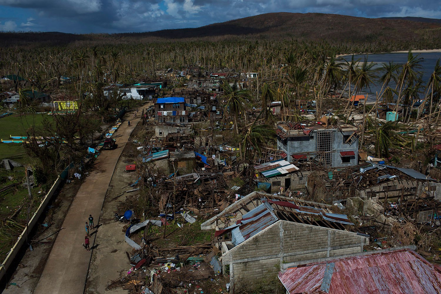 People from a remote island that was cut off by Haiyan Typhoon  walk on the street in the street in Homonhon Island, Philippines on November 14, 2013.