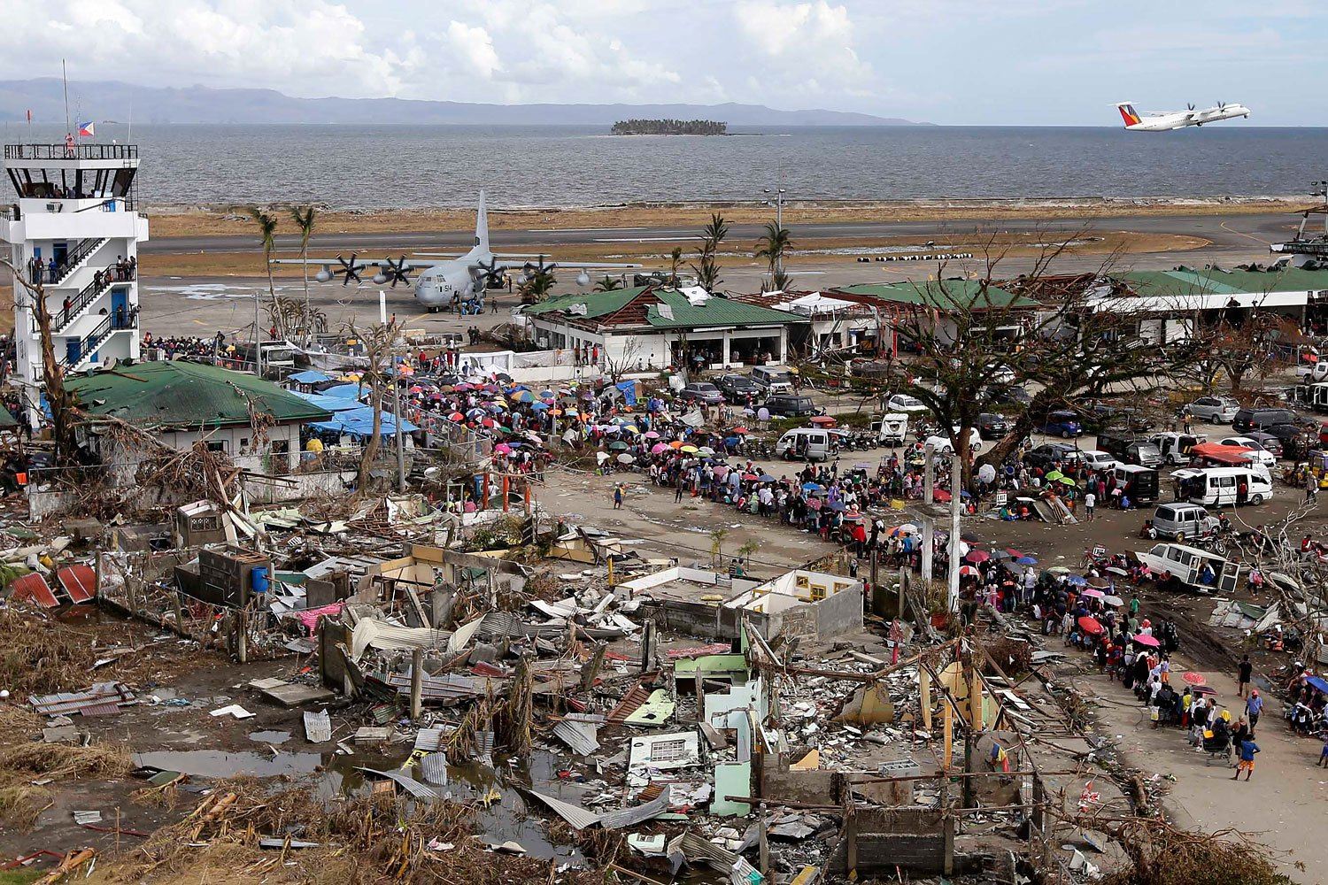 A view of Filipino typhoon survivors prior their boarding on a US C-130 plane in the super typhoon devastated city of  Tacloban, Leyte province, Philippines, November 13, 2013.