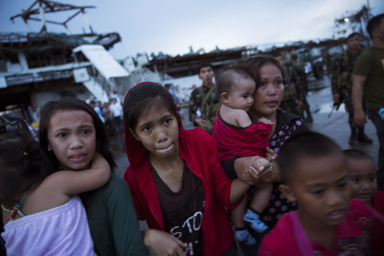 People effected by  Typhoon Haiyan react after being unable to board a US military aid evacuation flight from Tacloban Airport in Tacloban, on Leyte Island, Philippines on November 12, 2013.