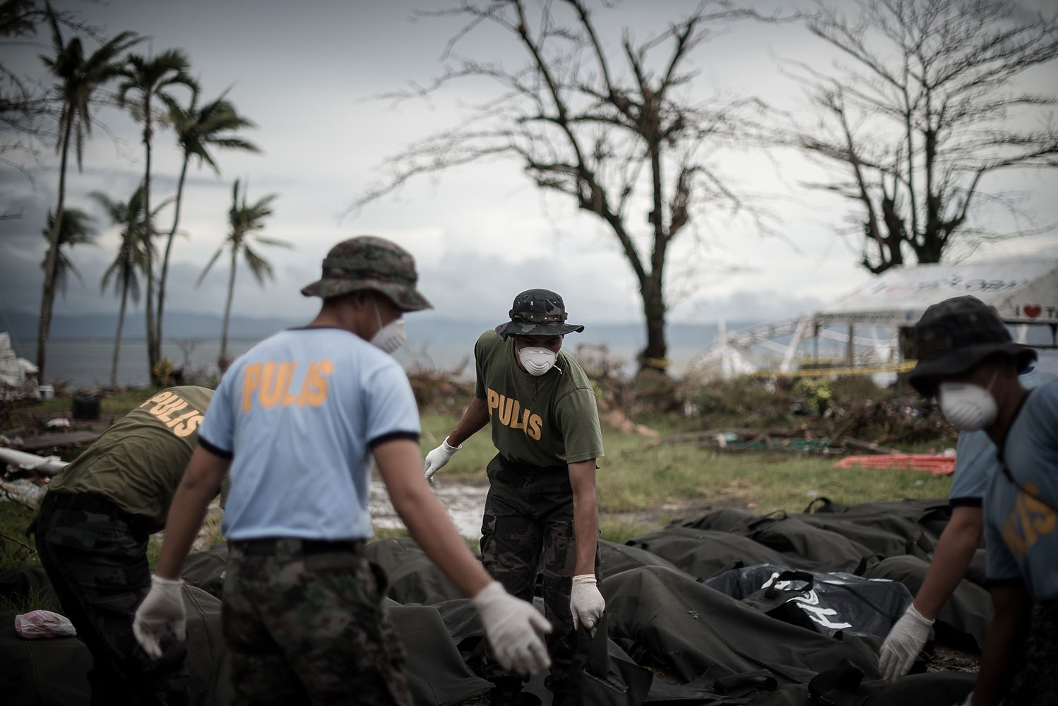 Dead bodies are unloaded at a makeshift morgue in Tacloban, on the eastern island of Leyte on November 12, 2013 after Super Typhoon Haiyan swept over the Philippines.