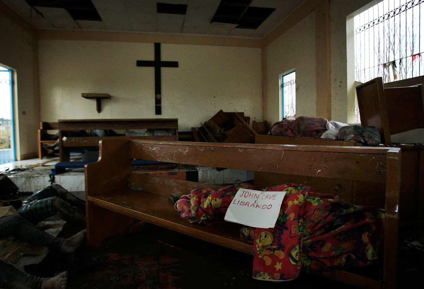A body wrapped in cloth labeled only with a name is left on a pew at St. Michael The Archangel Chapel in Tacloban, central Philippines, November 12, 2013.