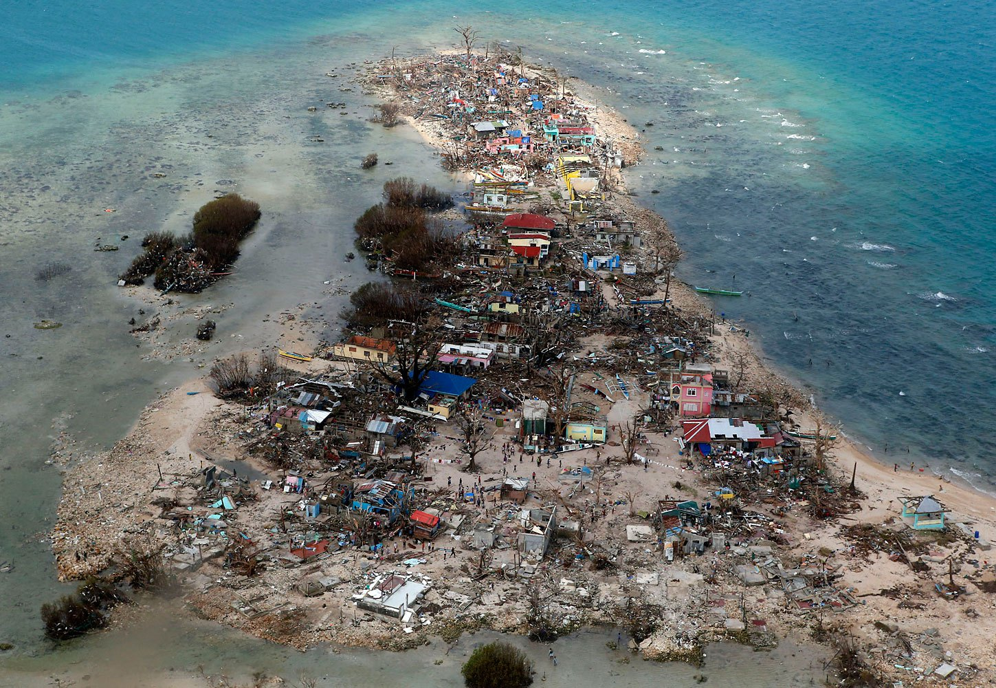 An aerial view of a coastal town, devastated by super Typhoon Haiyan, in Samar province in central Philippines, November 11, 2013.