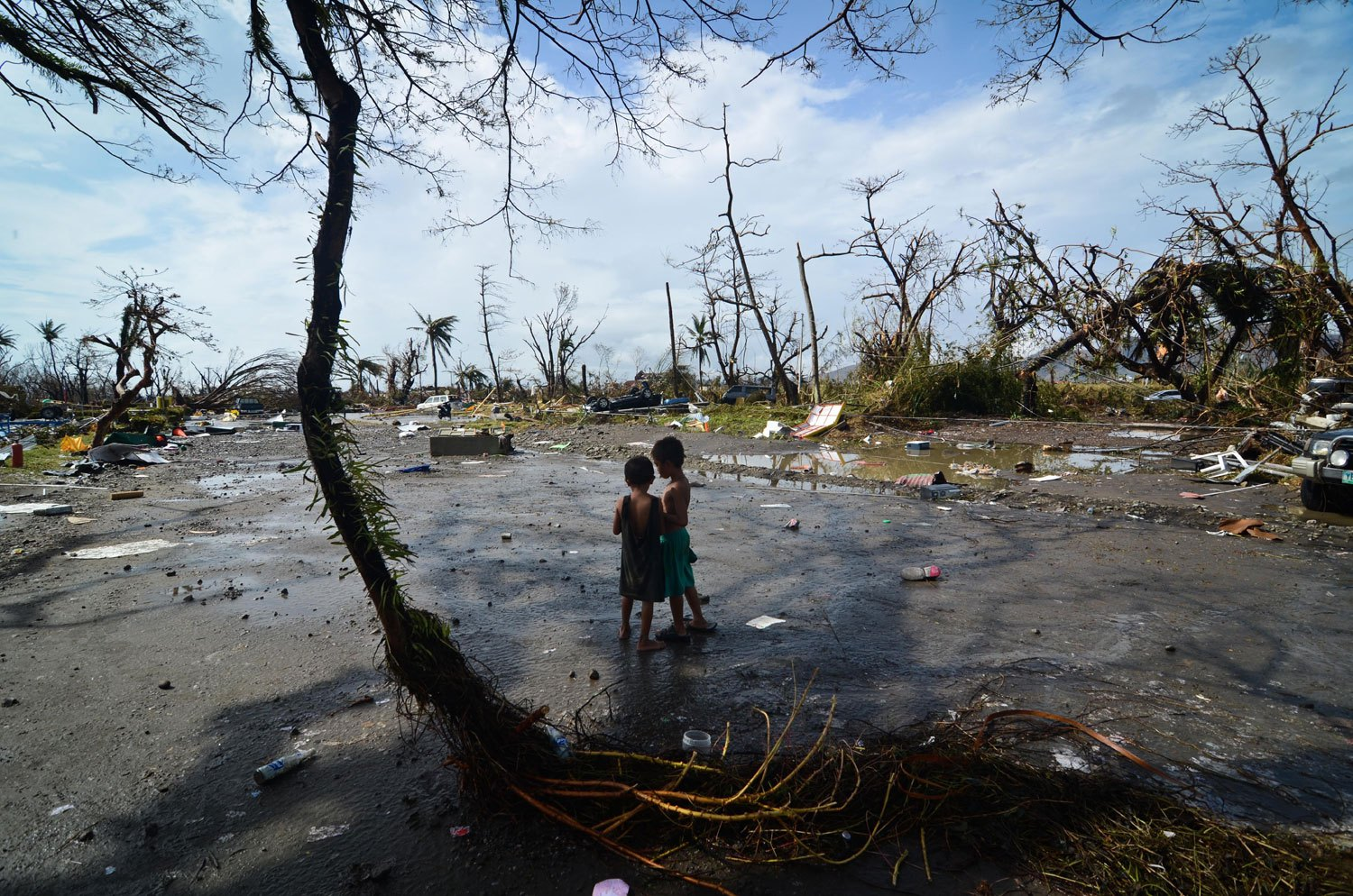 Two young boys look at the devastation in the aftermath of typhoon Haiyan on Nov. 10, 2013 in Tacloban City, Leyte, Philippines.