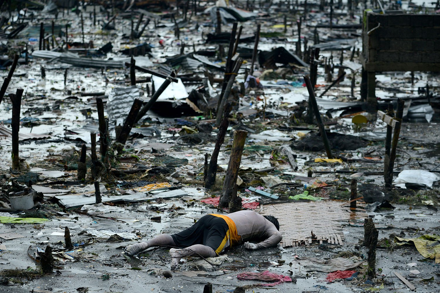 The body of a dead man is seen in Tacloban, in Leyte province, on Nov. 10, 2013, after Supertyphoon Haiyan swept over the Philippines