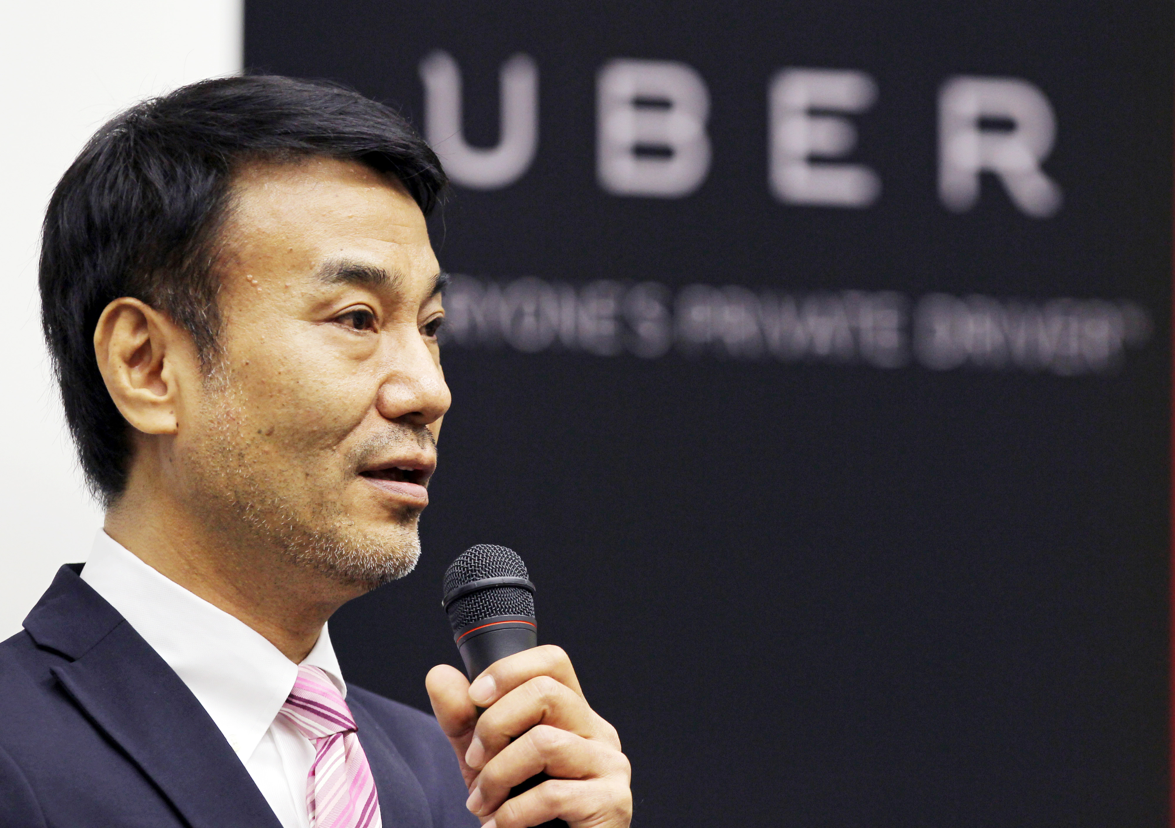Takeji  Tak  Shiohama, president of Uber Japan Co., speaks at a news conference in Tokyo, on March 3, 2014.