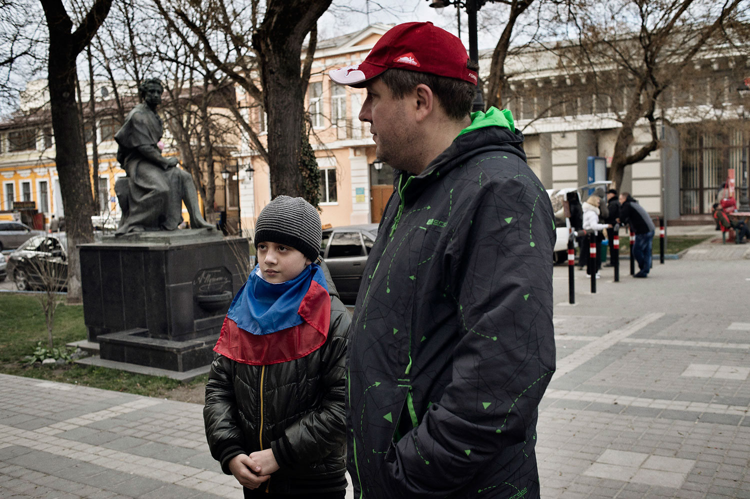 Ivan Drobkov, an ethnic Russian native of Crimea, walks near the regional parliament with his 9-year-old son Bogdan on March 17, 2014.