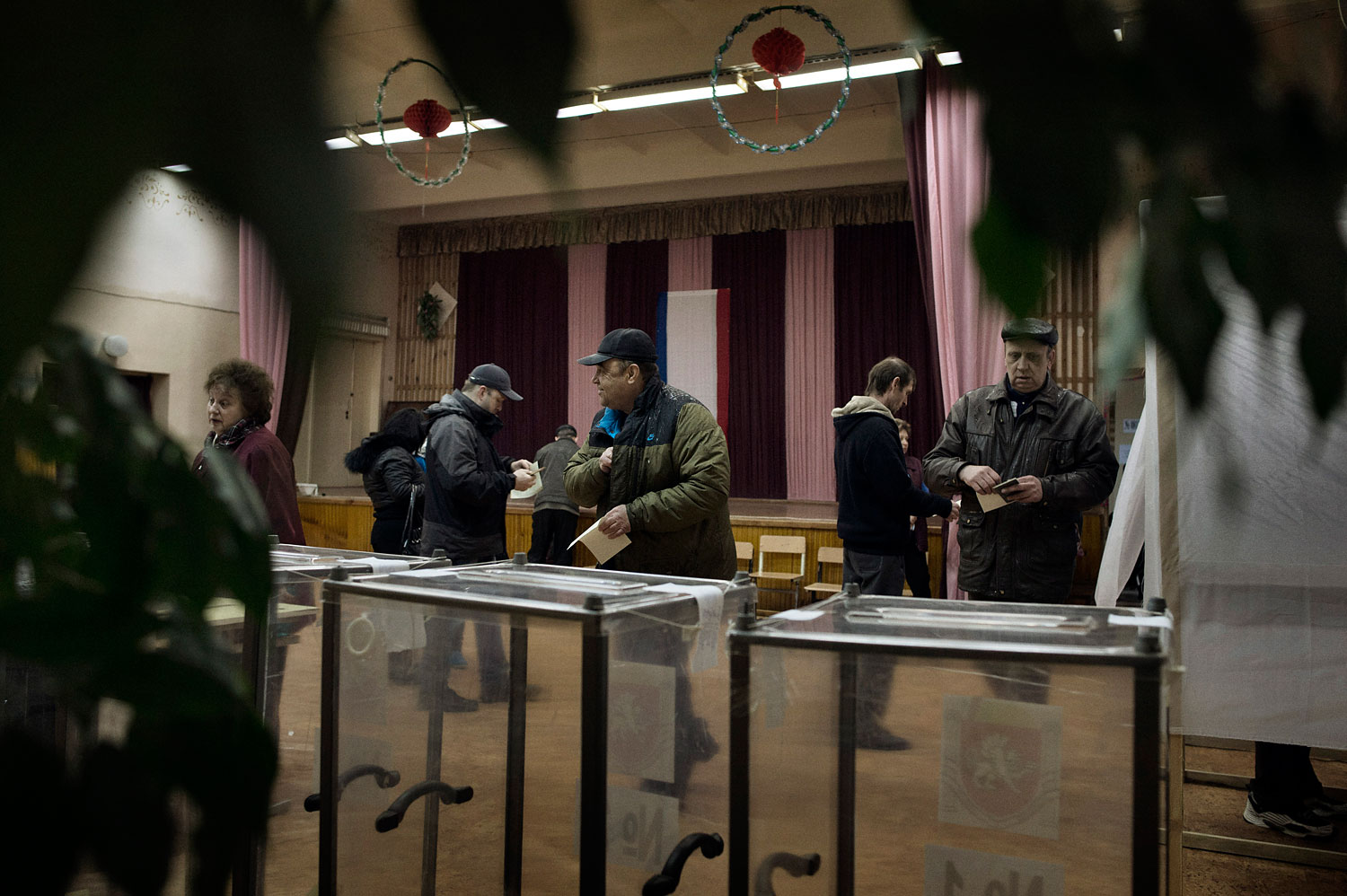 Residents of Crimea vote in a referendum on their region's secession from Ukraine and annexation into Russia on March 16, 2014.