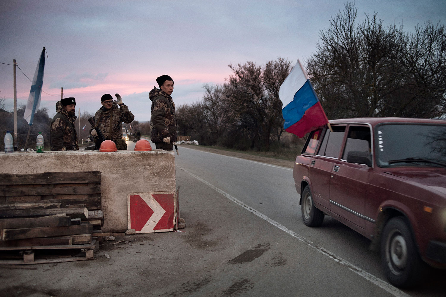 Members of the Cossack paramilitary force in Crimea guard a checkpoint on the highway leading to the city of Sevastopol, home of Russia's Black Sea naval fleet, on March 16, 2014.