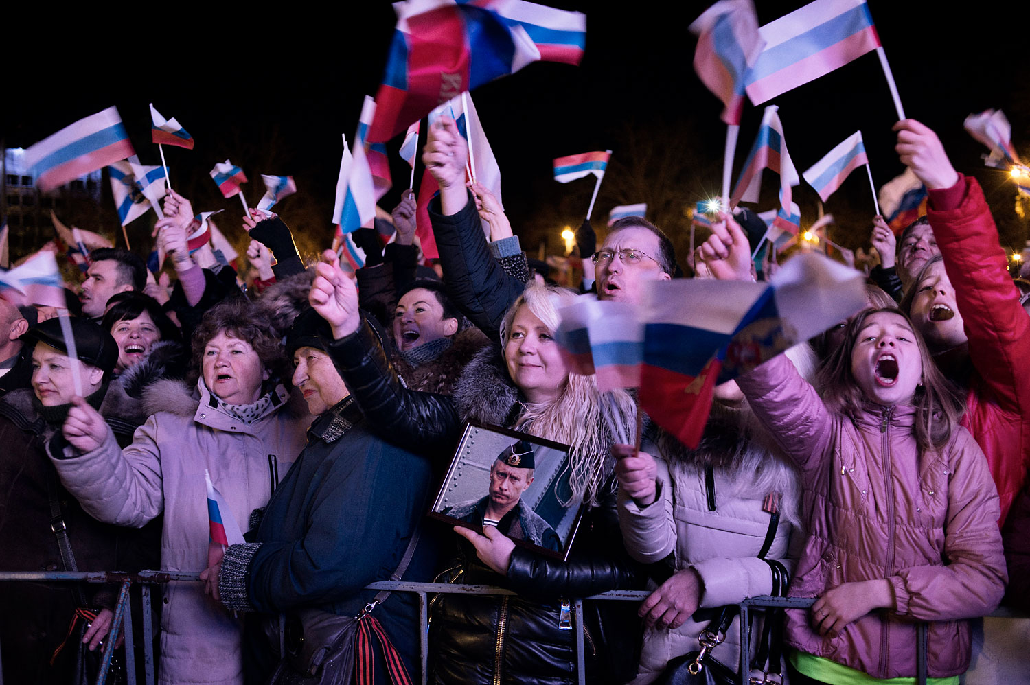 A jubilant crowd in Crimea waits for the results of the referendum in the Crimean city of Sevastopol on March 16, 2014.