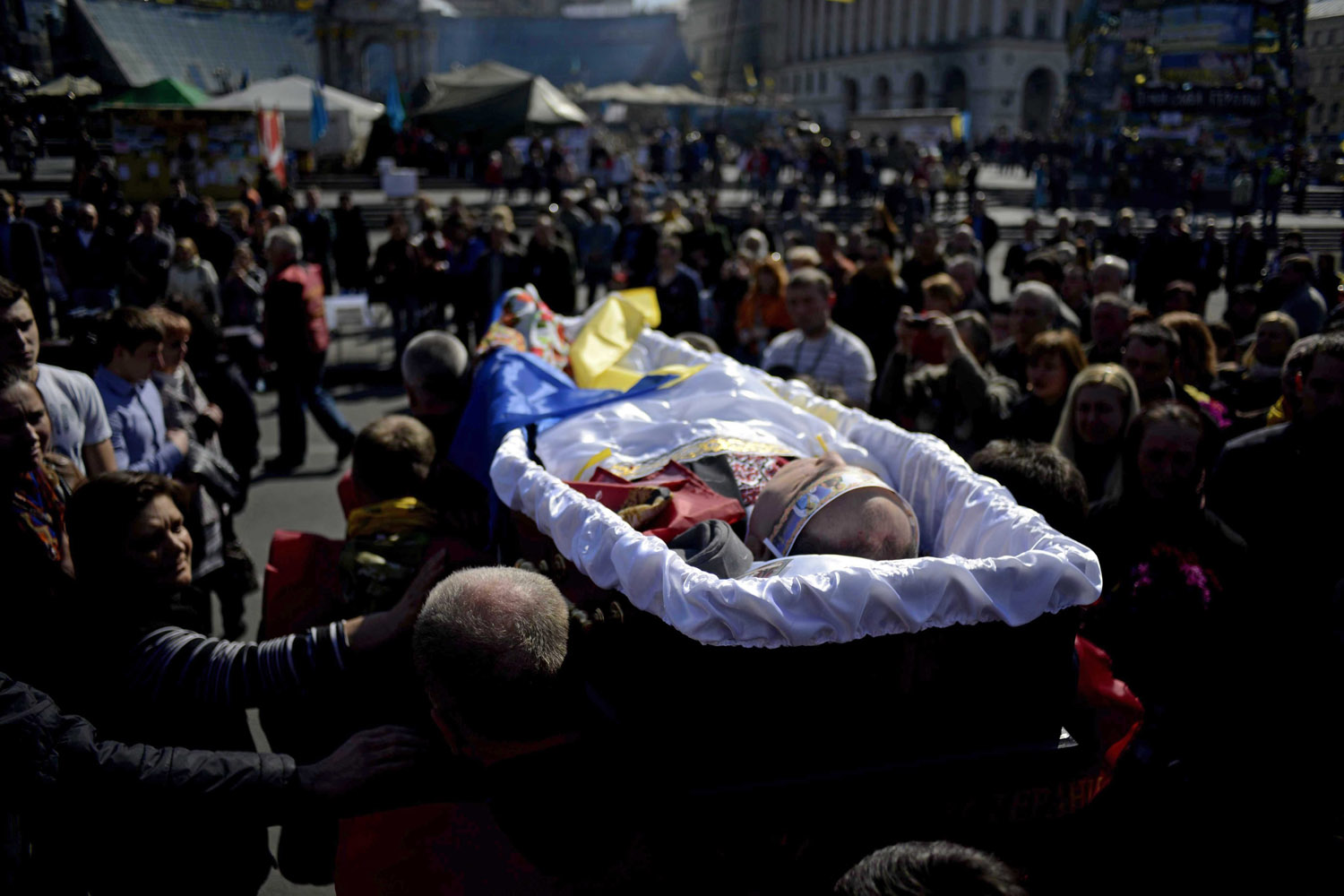 Mar. 25, 2014.  People attend the funeral ceremony of Petro Mironovich, a maidan activist, at Independence Square in Kiev, Ukraine. Mironovich, an Afghan war veteran, was an anti-government protester who died in a hospital after gas poisoning.