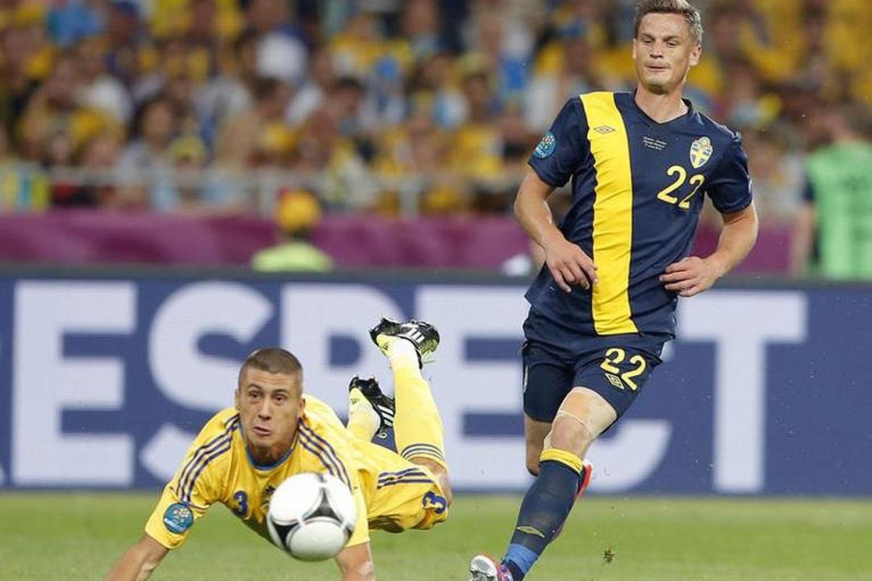 Sweden's Markus Rosenberg (R) challenges Ukraine's Yevhen Khacheridi during a soccer match at Olympic Stadium in Kiev in June 2012