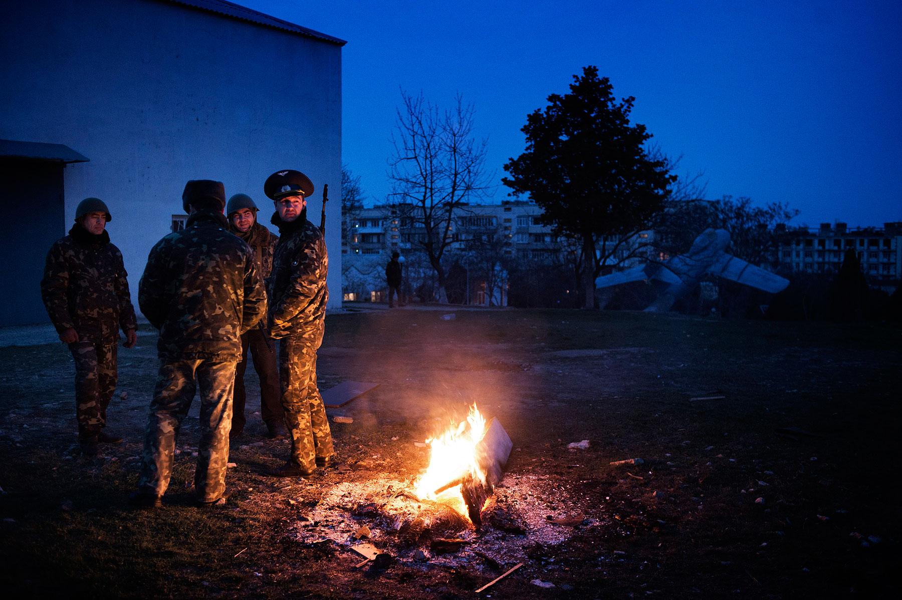 Ukrainian officers guard Belbek air base outside the Crimean city of Sevastopol on March 4
