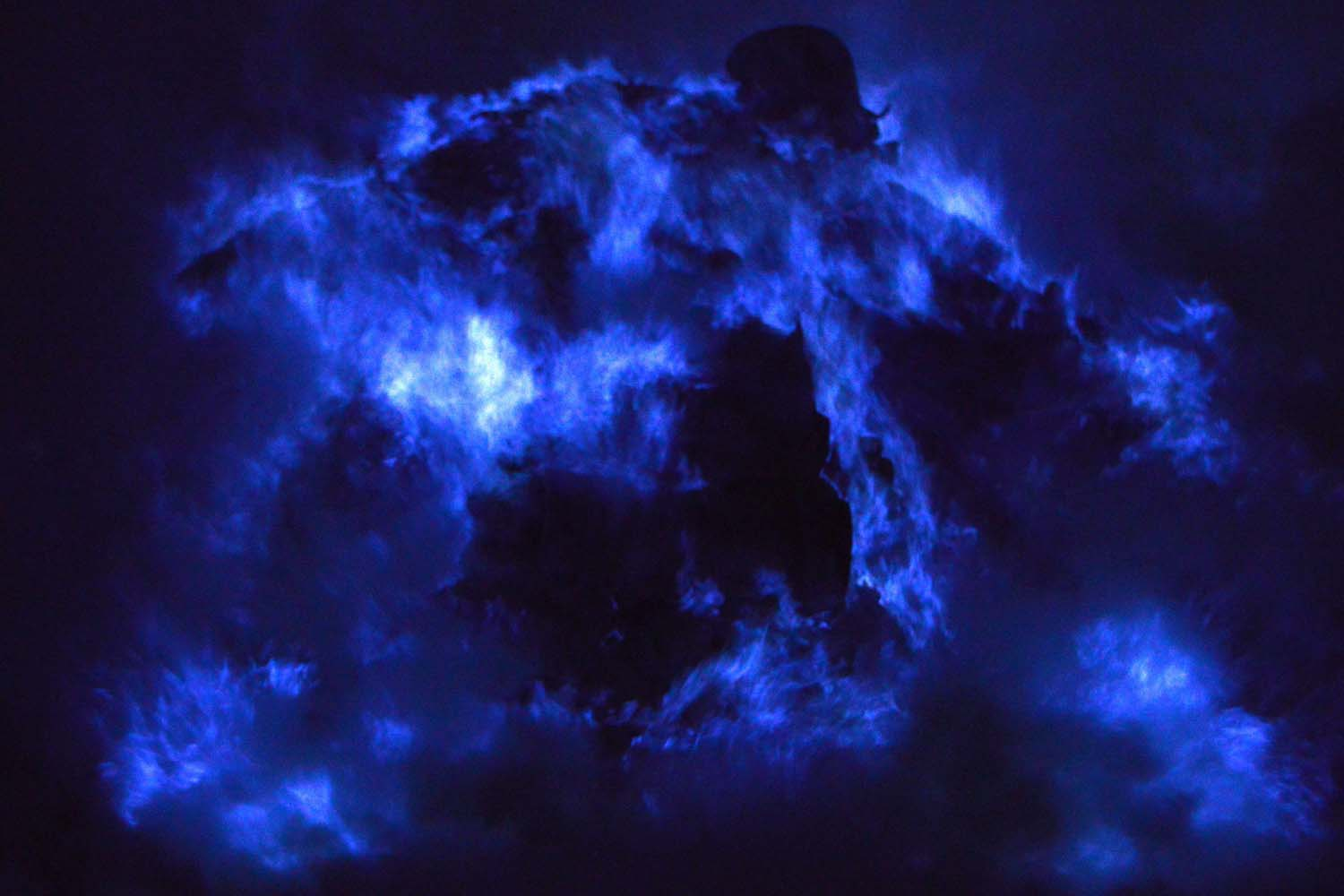 Mar. 22, 2014. The blue flame of burning sulfur at the crater of the Kawah Ijen volcano in Banyuwangi regency, East Java province. The natural phenomenon which can be seen at night is caused by sulfuric gases from the volcano which ignite into blue flames when they come into contact with the air.