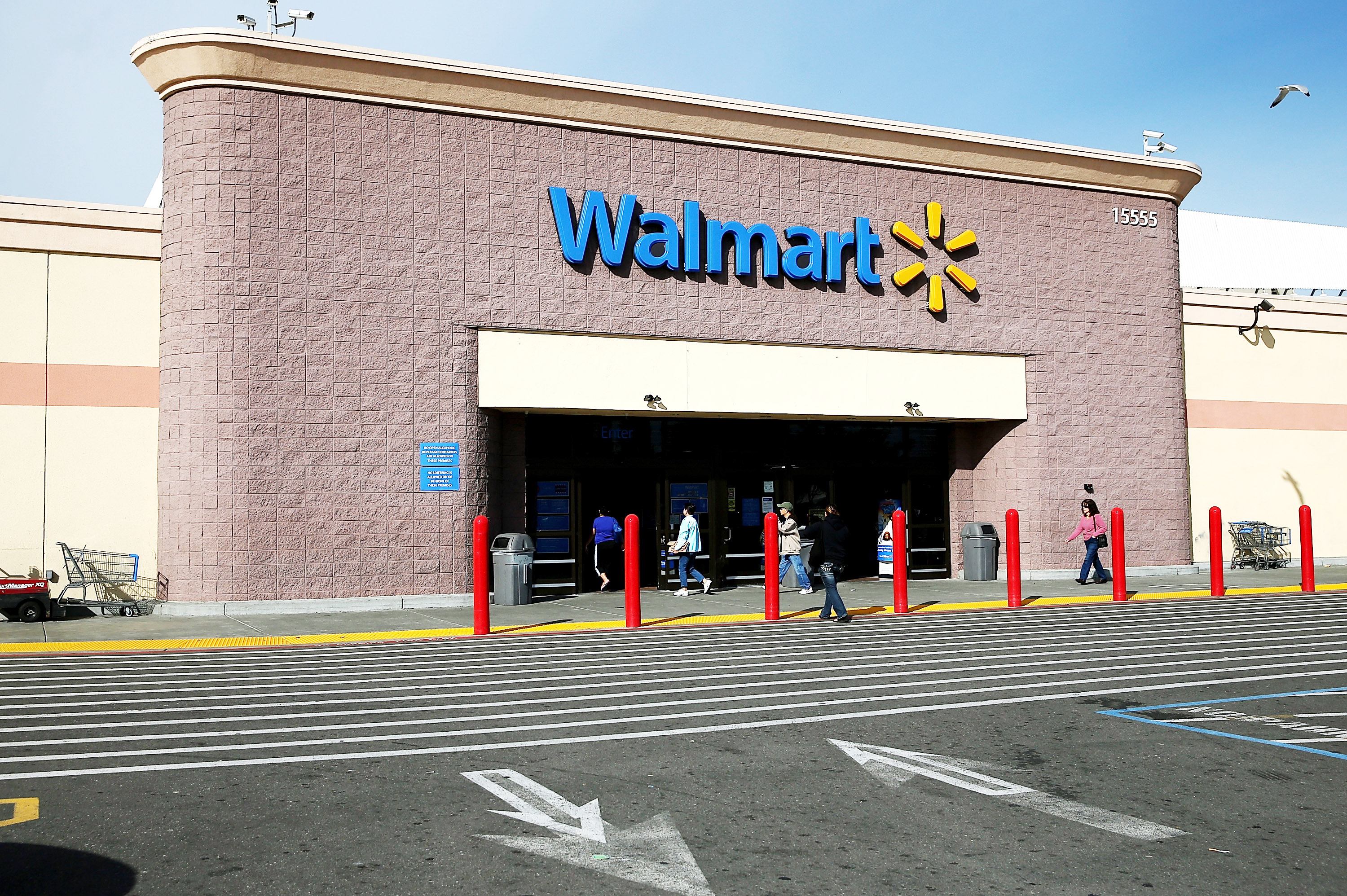 Customers enter a Wal-Mart store on Feb. 20, 2014 in San Lorenzo, Calif.