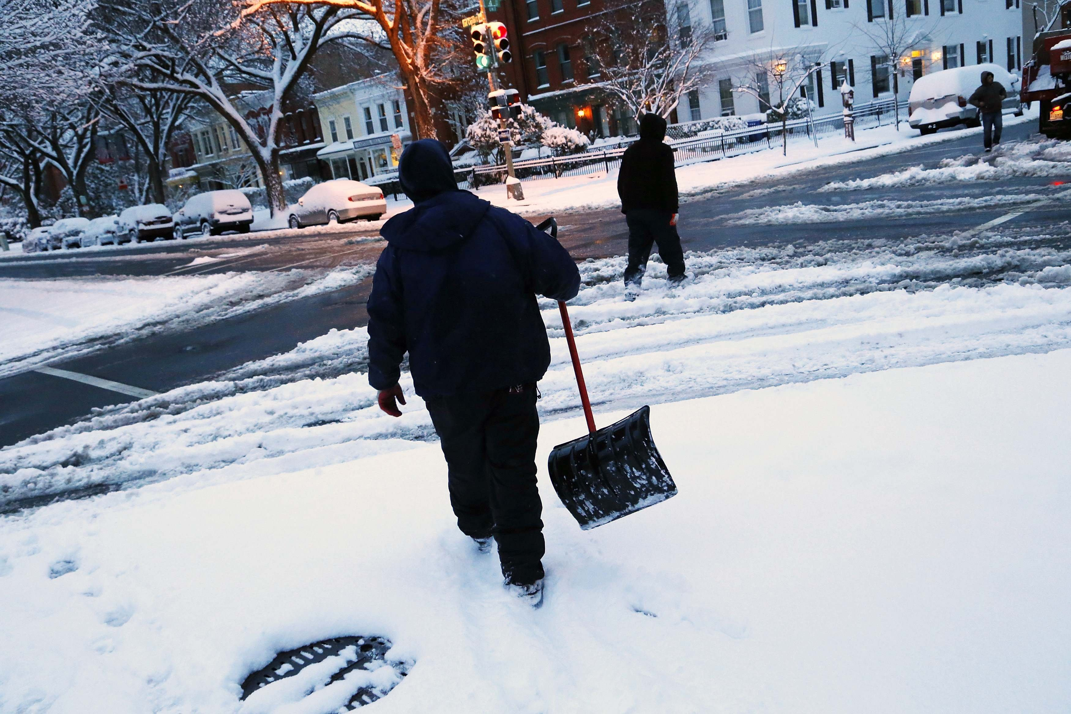 Snow shovelers in the Capitol Hill neighborhood in Washington, D.C., on March 17, 2014.