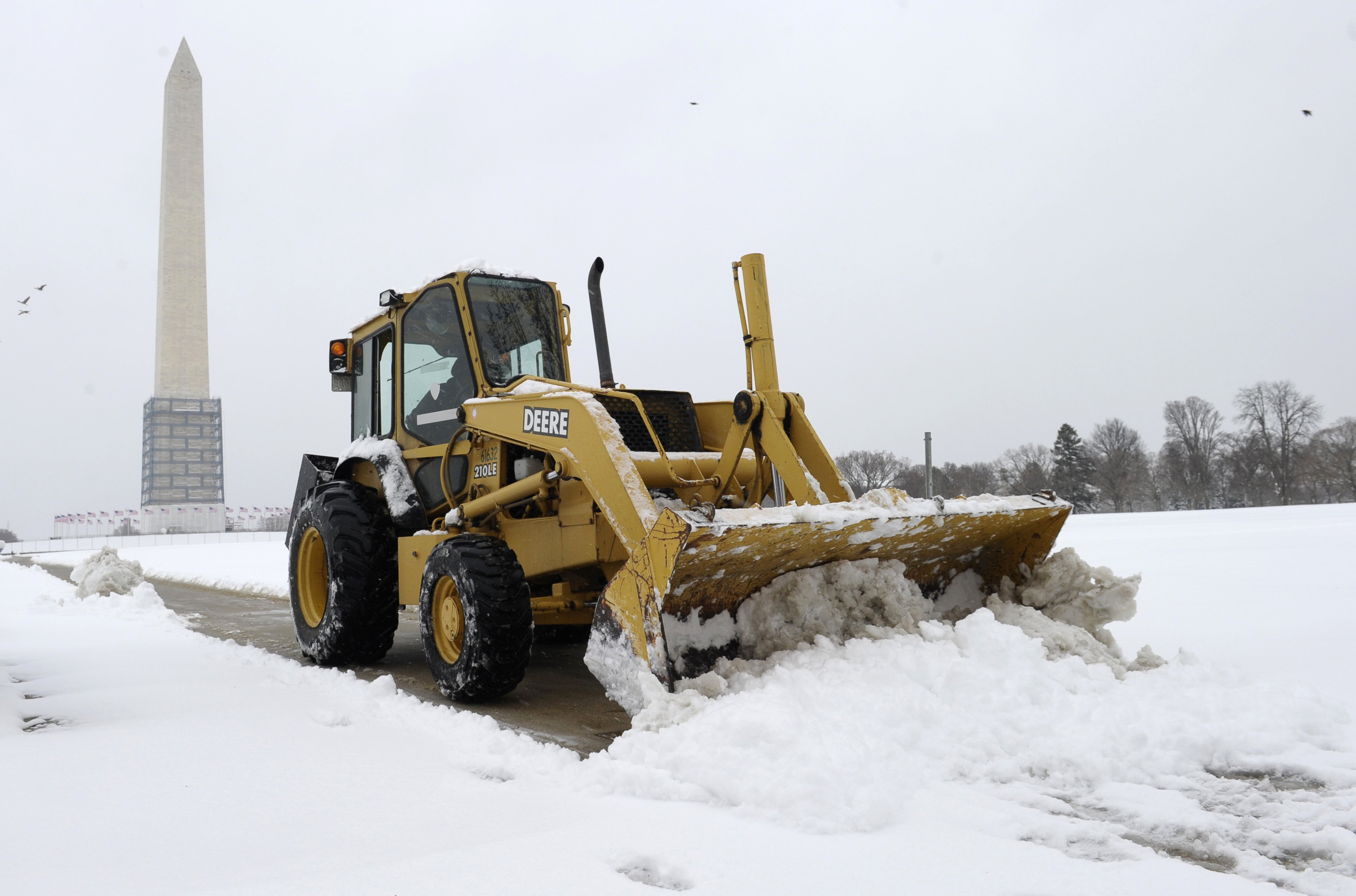 A snow plow clears the area around the Washington Monument in Washington, D.C. on March 17, 2014.