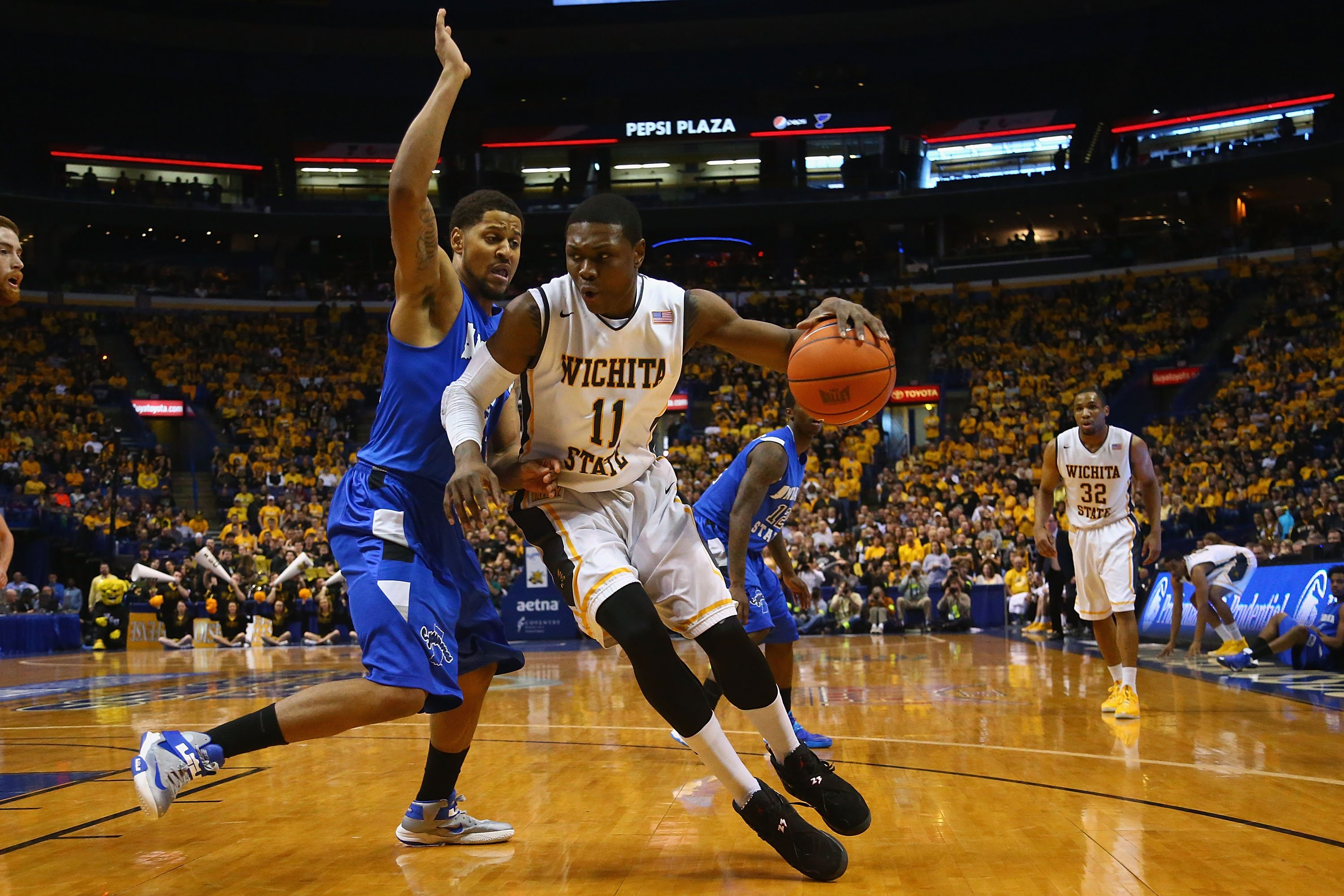 Cleanthony Early #11 of the Wichita State Shockers looks to get past Khristian Smith #32 of the Indiana State Sycamores during the MVC Basketball Tournament Championship game at the Scottrade Center on March 9, 2014 in St. Louis.