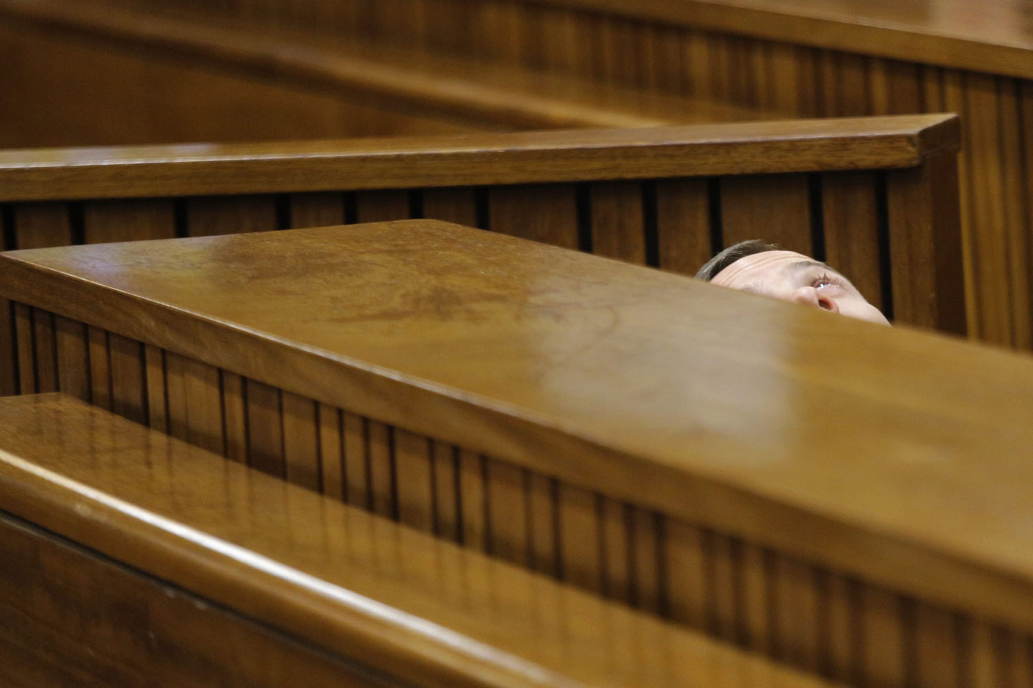 Mar. 14, 2014. African Paralympic athlete Oscar Pistorius is seen leaning back after applying eye drops as he prepares himself for another day in the dock during his ongoing murder trial in Pretoria, South Africa,