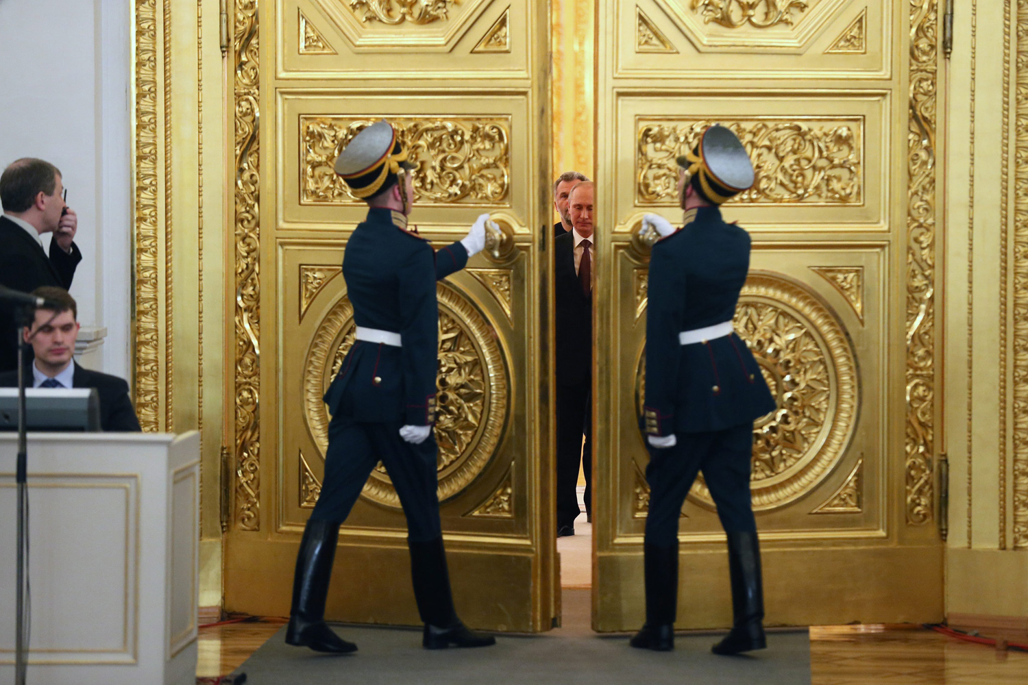 Mar.18, 2014. Russia's President Vladimir Putin arrives to sign a treaty with Crimean leaders on reunification with Russia in the Grand Kremlin Palace in Moscow, Russia. Crimea and Sevastopol will join Russia as two separate regions, President Putin said, adding that he would sign treaties immediately.