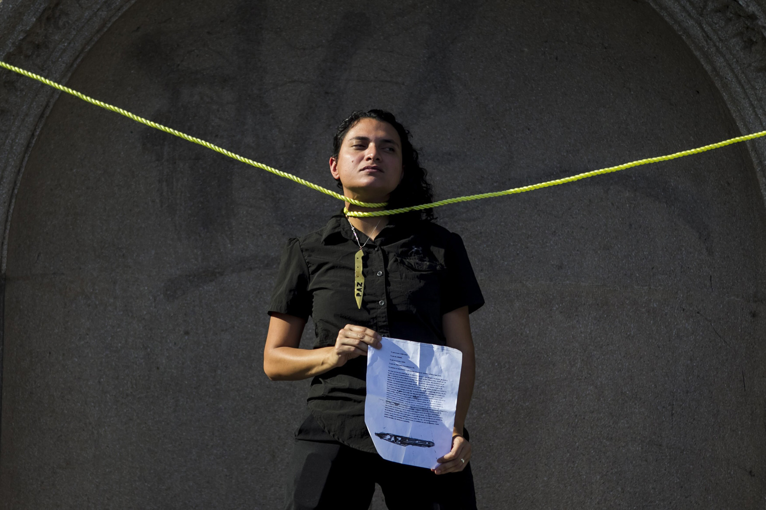 Mar. 18 , 2014. A woman presents a performance about Venezuela's crisis during a protest at Altamira Square in Caracas, Venezuela, Since mid February, 27 people including opposition activists, pro-government supporters and at least one police officer have died across the country in anti-government protests.