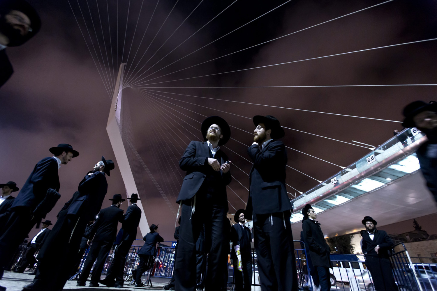 Mar.19, 2014. Ultra-Orthodox Jewish men gather under the Chords Bridge during a demonstration against military conscription held at the entrance to Jerusalem.