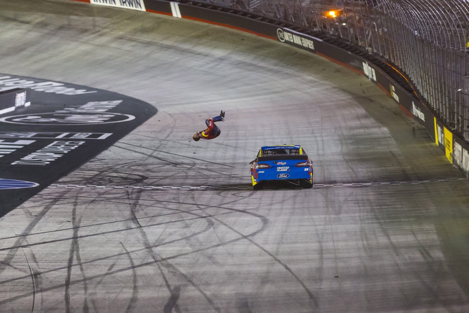 Mar. 16, 2014 - Driver Carl Edwards does a back flip off after winning the Sprint Cup series Food City 500 at Bristol Motor Speedway.