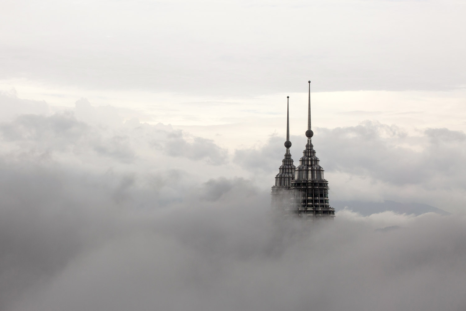 Mar. 18, 2014. The pinnacles of the Petronas Twin Towers protrude through low clouds in Kuala Lumpur.