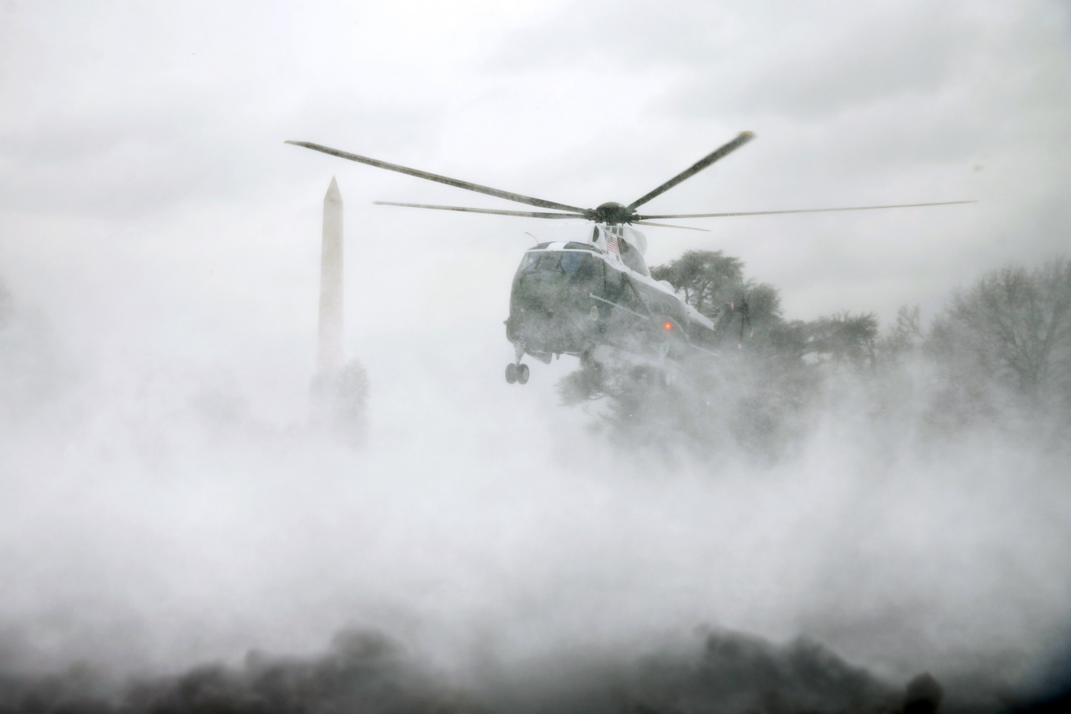 Mar. 17, 2014. Marine One helicopter carrying President Barack Obama arrives on the South Lawn of the White House in Washington, after Obama visited wounded service members at Walter Reed National Military Medical Center.
