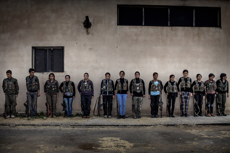 YPG recruits listen to their instructor at the training camp near al-Malikiyah (Derik).