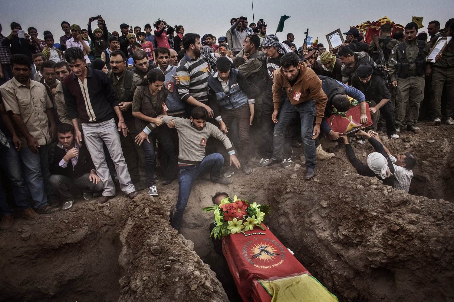 Relatives attend the funeral of four YPG fighters killed in the battles against the Nusra Front near Ramelan.
