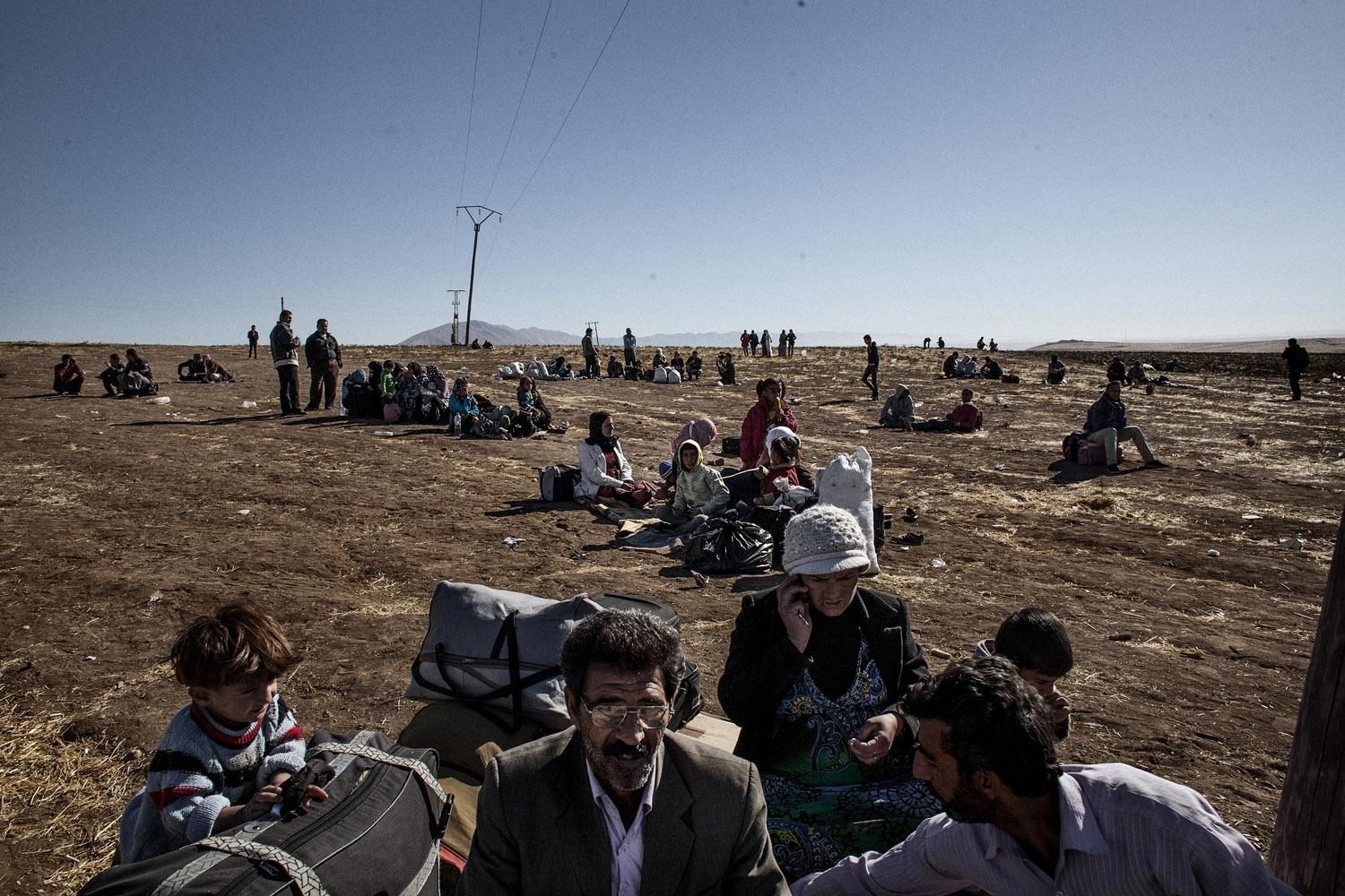 The following images were taken in the Kurdish areas of Syria and Iraq in October 2013.                                                              Internally displaced Kurds wait near the Syrian side of the border with Iraq.
