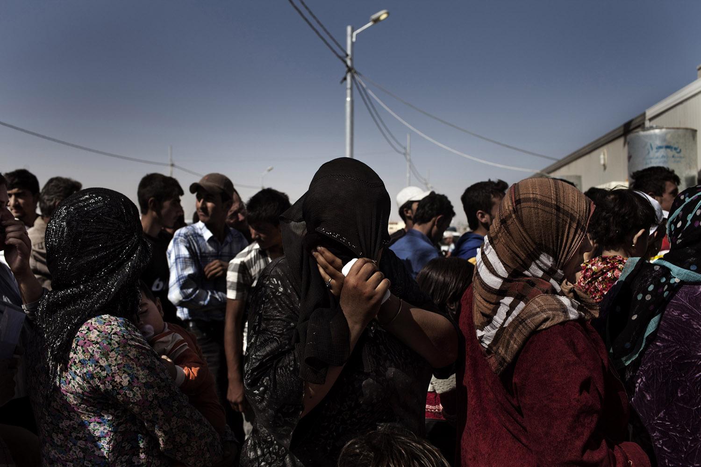 Syrian Kurds wait in the registration line at the Kawergosk refugee camp near Erbil, Iraqi Kurdistan.