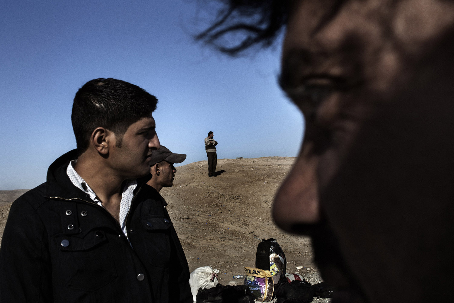 Syrian refugees stand near the Syrian side of the border with Iraq as they flee the war. Fighting between jihadis and Syrian-Kurdish forces helped drive the exodus of refugees.