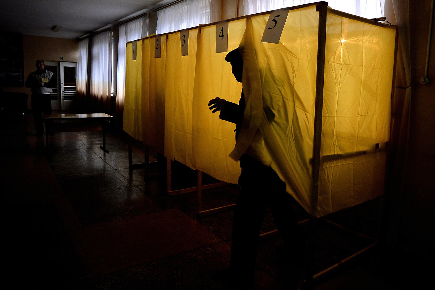Mar. 16, 2014. A man exits a voting booth after casting his vote in a local school in Simferopol. People in Crimea took to the polls to vote on a referendum on breaking away from Ukraine to join Russia that has precipitated a Cold War-style security crisis on Europe's eastern frontier.