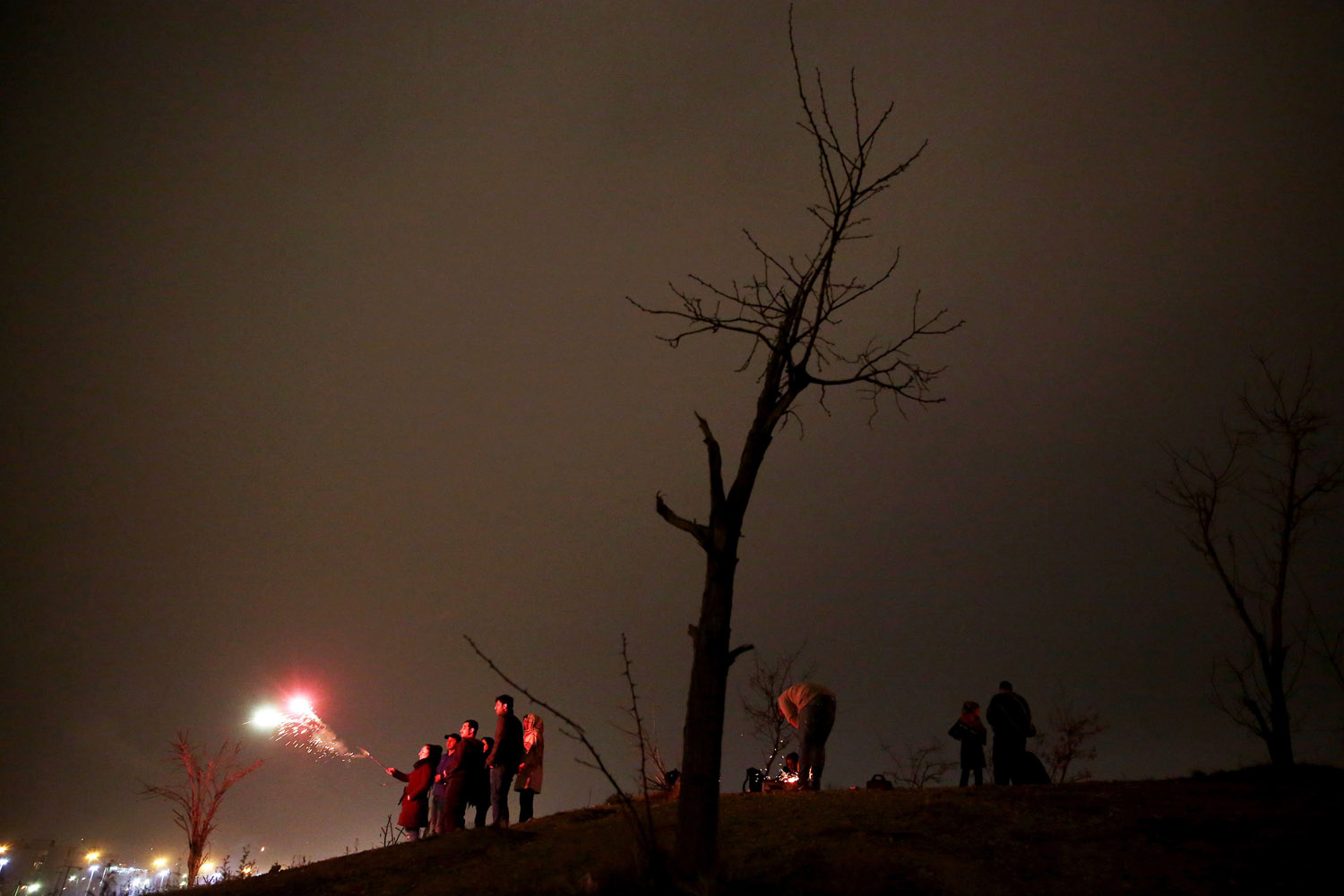 Mar. 18, 2014. An Iranian woman lights fireworks during a celebration, known as Chaharshanbe Souri, or Wednesday Feast,  marking the eve of the last Wednesday of the solar Persian year, in Pardisan park, Tehran, Iran.