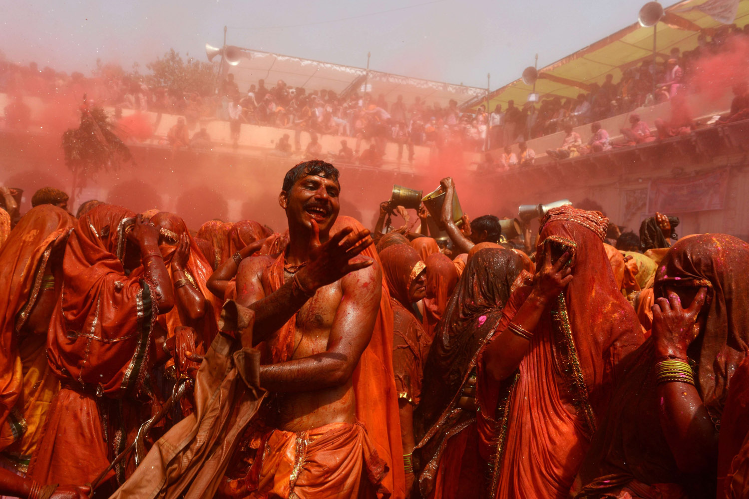 Mar. 18, 2014. Indian revelers take part in the game of 'Huranga' at The Dauji Temple in Mathura, south of New Delhi. 'Huranga' is a game played between men and women a day after Holi during which men drench women with liquid colors and women tear off the clothes of the men.
